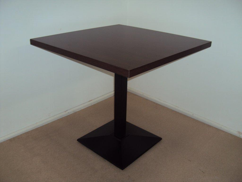 Professional wooden table with cast iron base and walnut for Table 99 restaurant