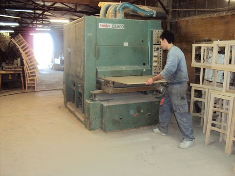 Wood cutting machine at Zampoukas Furniture Factory